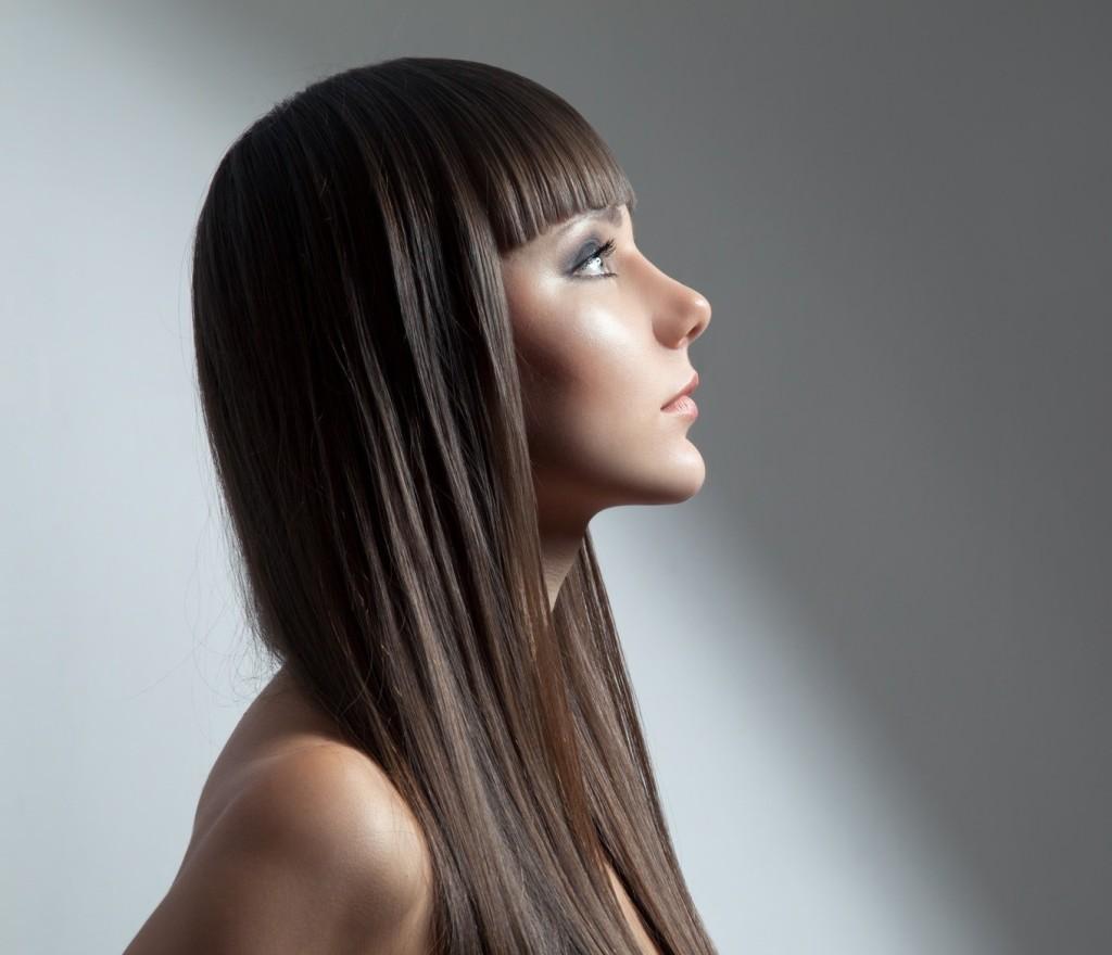 Hair. Beautiful Brunette Girl. Healthy Long Hair. Beauty Model Woman. Hairstyle